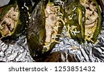 stuffed green chile peppers ... | Shutterstock . vector #1253851432