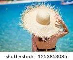 woman in bikini on beach ... | Shutterstock . vector #1253853085
