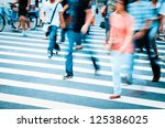 people walking on big city... | Shutterstock . vector #125386025