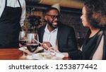 african american couple making...   Shutterstock . vector #1253877442