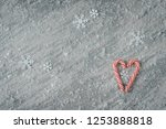 Two Candy Canes Making A Heart...