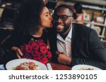 african american couple dating... | Shutterstock . vector #1253890105