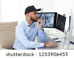 male security guard with... | Shutterstock . vector #1253906455