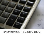 old calculator and some numbers ... | Shutterstock . vector #1253921872