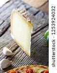 fresh italian  pizza on wood.... | Shutterstock . vector #1253924032