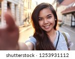 portrait of a smiling young... | Shutterstock . vector #1253931112