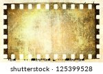 grunge film strip frame | Shutterstock . vector #125399528