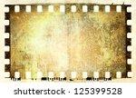 grunge film strip frame | Shutterstock . vector #125399528