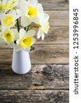 white daffodils at china vase... | Shutterstock . vector #1253996845