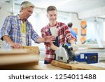 positive young carpentry... | Shutterstock . vector #1254011488