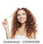 smiling blonde woman with... | Shutterstock . vector #1254045208