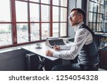 thinking young writer at work... | Shutterstock . vector #1254054328