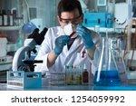 hands of scientist working with ... | Shutterstock . vector #1254059992