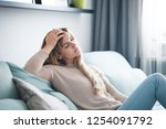 sad woman sitting on sofa at... | Shutterstock . vector #1254091792