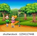 two school children are walking ... | Shutterstock .eps vector #1254117448
