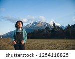 girl in tirol mountains   Shutterstock . vector #1254118825