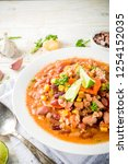 chili con carne in plate on... | Shutterstock . vector #1254152035