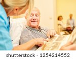 old man with alzheimer's looks... | Shutterstock . vector #1254214552