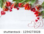 red curly tulips and hearts on... | Shutterstock . vector #1254273028