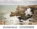 stormy weather in rock arch in... | Shutterstock . vector #1254300808