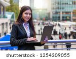 attractive woman in corporate... | Shutterstock . vector #1254309055
