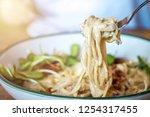 carbonara in the white bowl.... | Shutterstock . vector #1254317455