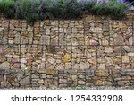gabion wall with plands... | Shutterstock . vector #1254332908