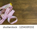 tape measure with wooden... | Shutterstock . vector #1254339232
