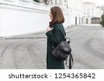 backpack in woman's hands.... | Shutterstock . vector #1254365842