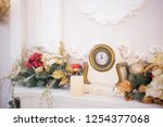 clock on the fireplace new year ... | Shutterstock . vector #1254377068