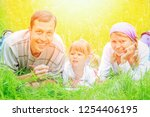 family outdoors playing in the... | Shutterstock . vector #1254406195