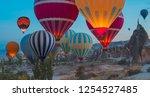hot air balloon flying over... | Shutterstock . vector #1254527485