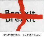 torn paper with word brexit...