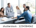 sharing opinions. group of... | Shutterstock . vector #1254584062