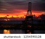 sunset over harbour docks | Shutterstock . vector #1254590128