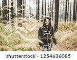 young asian travel backpacker... | Shutterstock . vector #1254636085