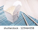 box with cooked rice with... | Shutterstock . vector #125464358
