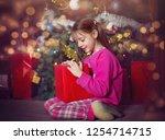 cute little girl with christmas ...   Shutterstock . vector #1254714715
