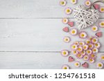 daisies  petals and hearts on a ... | Shutterstock . vector #1254761518