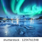 northern lights above snowy... | Shutterstock . vector #1254761548