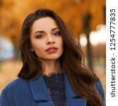 stylish fashionable woman in... | Shutterstock . vector #1254777835
