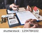 estate agent broker giving pen... | Shutterstock . vector #1254784102
