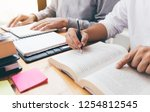teenage student works on... | Shutterstock . vector #1254812545