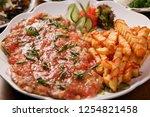 chicken cutlet on a plate | Shutterstock . vector #1254821458