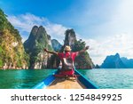 man traveler on boat joy fun... | Shutterstock . vector #1254849925
