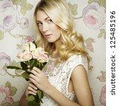 portrait of a beautiful blonde... | Shutterstock . vector #125485196
