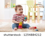 cute baby playing with pyramid... | Shutterstock . vector #1254884212