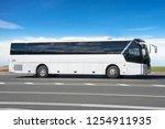 White Tourist Bus On The...
