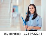 professional woman holding... | Shutterstock . vector #1254932245