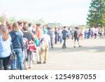 crowd of people in line | Shutterstock . vector #1254987055